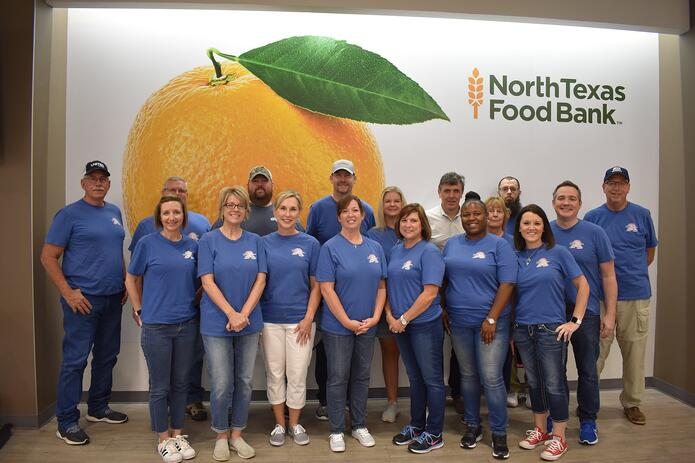 shippers group corporate associates volunteer to pack supplemental grocery boxes for seniors at north texas food bank