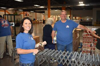 shippers group volunteers help pack commodity boxes at north texas food bank