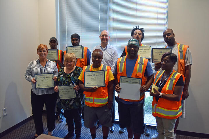 Austell Townhall August participants smiling for a group picture with their certificates of completion