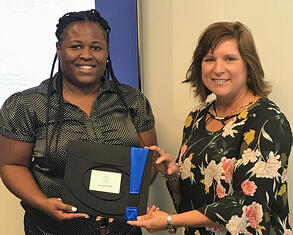 TSG's Payroll Administrator, Eliza Willis accepts recognition for 5 years of service from Diane Villafana, VP of HR & Safety