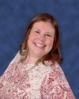 Headshot of TSG's Sarah Sheppard smiling