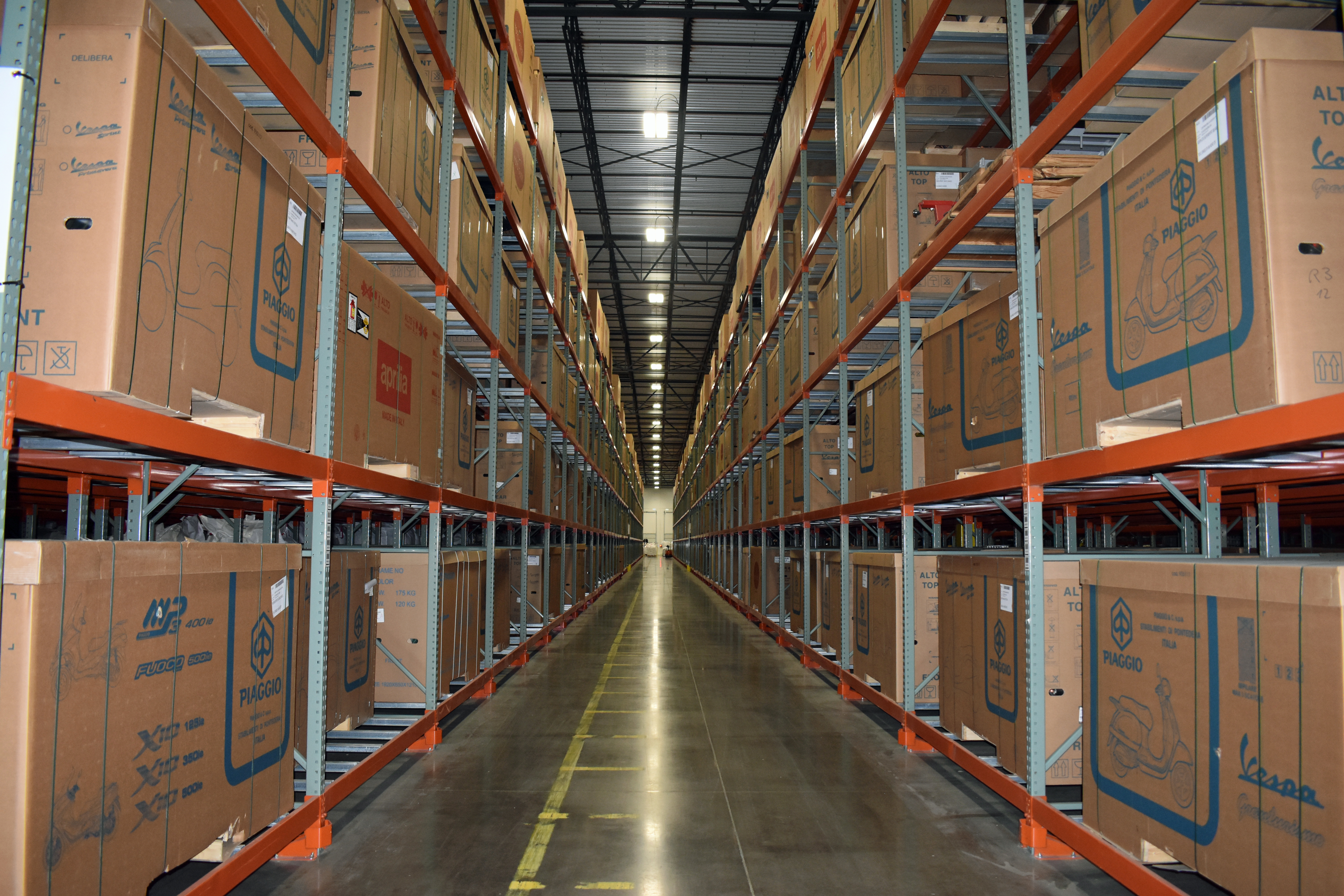 The Shippers Group Wintergreen facility stacked from floor to ceiling with uniform boxes of product neatly arranged in rows on racks