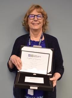 Nancy Landers holding certificate of appreciation