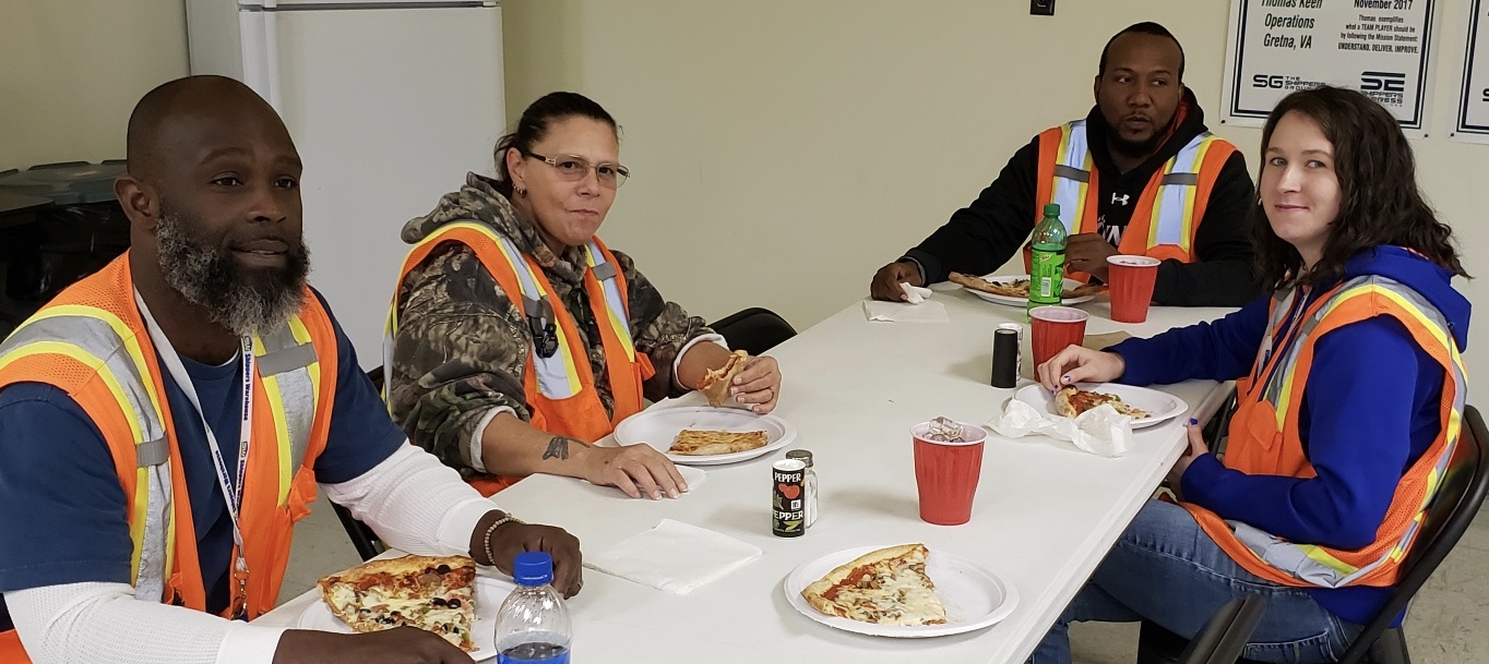 Team members from The Shippers Group Gretna location celebrate 730 days accident-free over a pizza lunch celebration